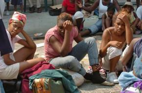 New Orleans residents wait for a bus out of the city following Hurricane Katrina
