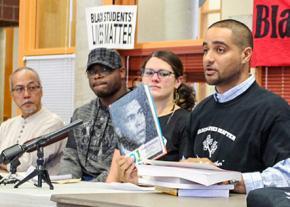 Garfield High School teacher Jesse Hagopian (right) speaks about anti-racism in school curricula