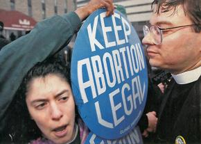 Anti-choice and pro-choice sides squared off outside women's health clinics