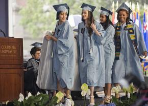 Emma Sulkowitz (left) graduates from Columbia University