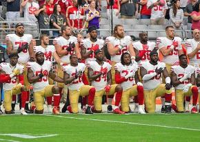 Members of the San Francisco 49ers take a knee against racism