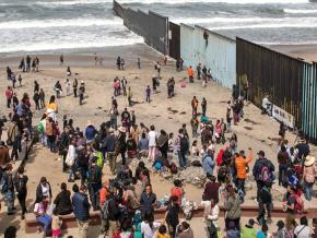 A caravan of Central American migrants reaches the U.S.-Mexico border
