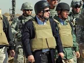 Senator John McCain (center) tours U.S. military installments in Iraq in 2007