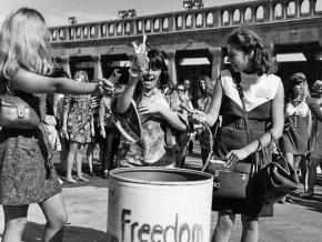 """Demonstrators toss symbols of sexism into the """"Freedom Trash Can"""""""