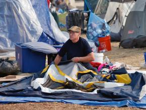 Fire evacuees live in temporary shelters by a Walmart in Chico, California