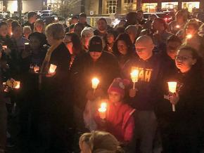 Mourners hold a vigil for Vicki Lee Jones and Maurice E. Stallard in Jeffersontown, Kentucky