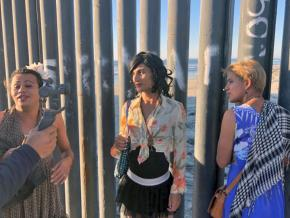 Members of the migrant caravan reach the U.S.-Mexico border in Tijuana