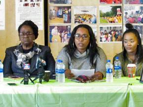 Marcus Deon Smith's mother Mary Smith (left) and sister Kim Suber (center) address reporters