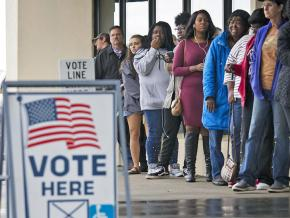 Voters line up outside a polling place on Election Day