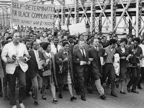 Supporters of community control for Ocean Hill-Brownsville march across the Brooklyn Bridge