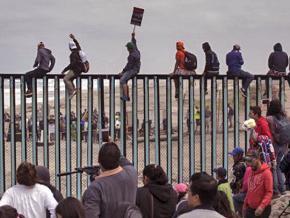 Welcoming members of the migrant caravan as they reach the border at Tijuana