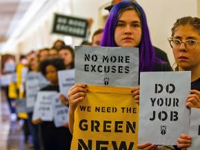 Protesters demand a Green New Deal outside the offices of leading House Democrats