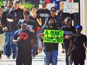 Protesters march against the police murder John Crawford III in Beavercreek, Ohio
