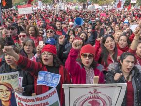 Striking teachers rally in front of City Hall in Los Angeles