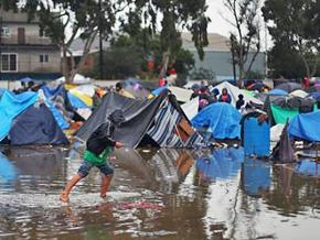 A refugee camp is flooded by rainfall in Tijuana, Mexico