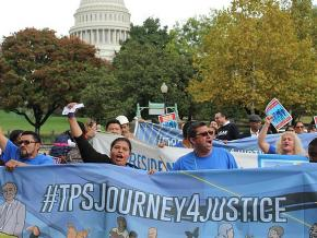 Immigrant rights activists march in defense of TPS recipients in Washington